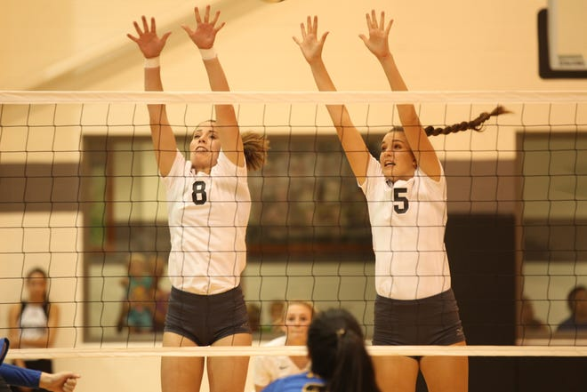 Water Valley High School's Cayce Jackson (8) and Baily Dawson try to block a shot by Veribest during a District 7-2A volleyball match at the Water Valley gym on Tuesday, Oct. 9, 2018.