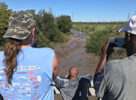 People Watch Water Come In At Fm 2288