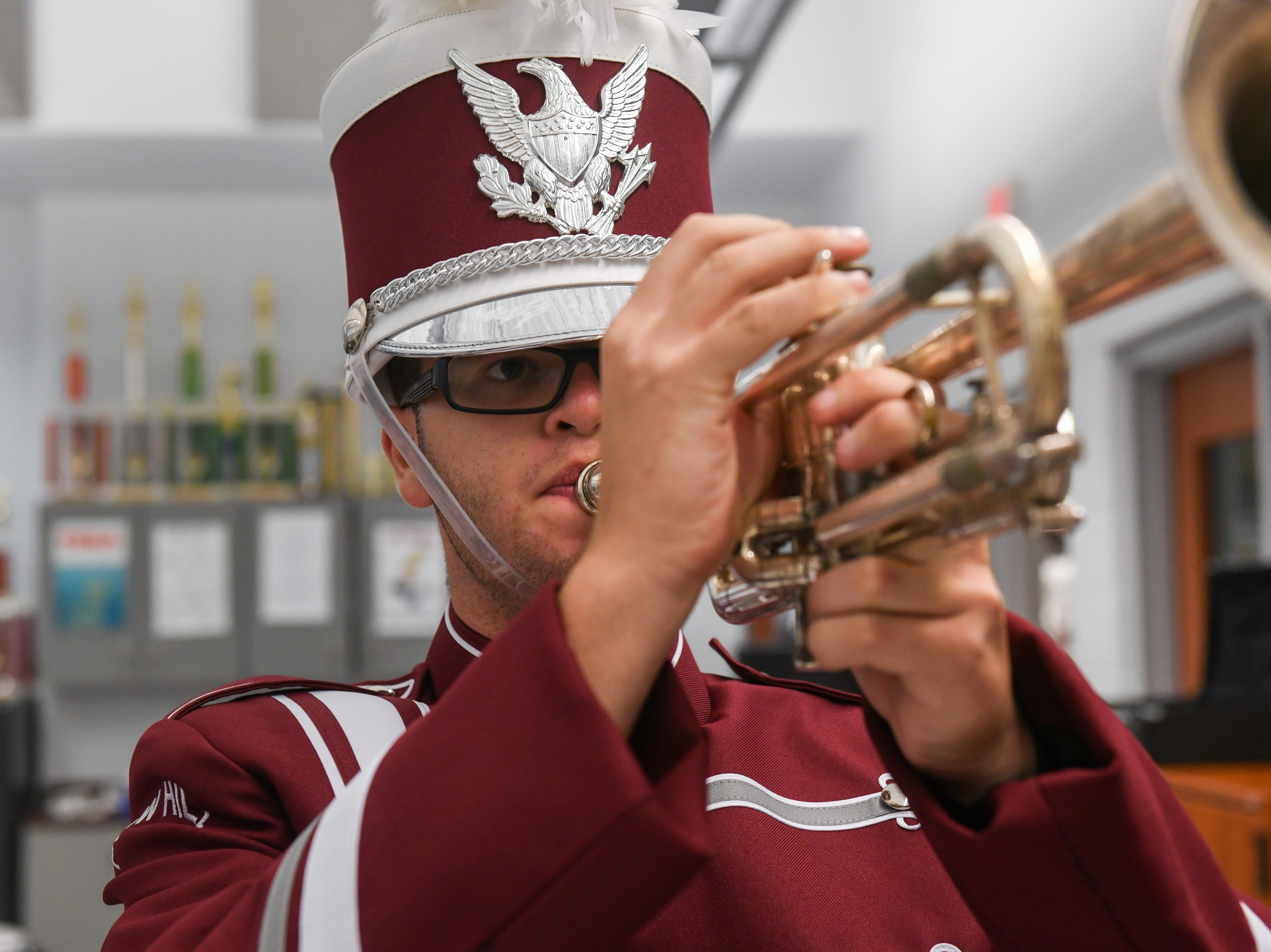 High school senior Justin Gentry poses in his new band uniform in Snow Hill on Wednesday, Oct 10, 2018.