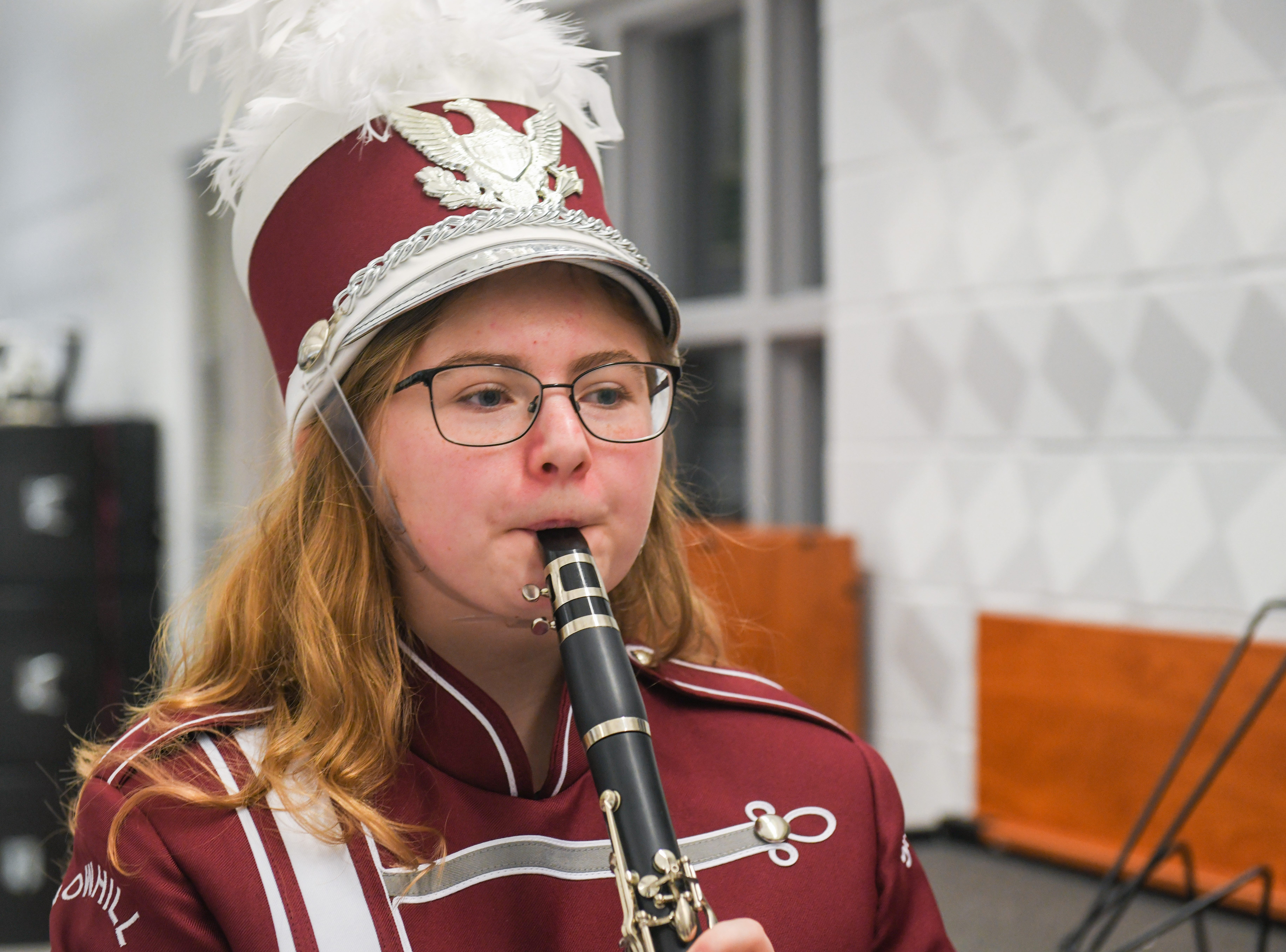 High school freshman Rebecca Eura poses in her new band uniform in Snow Hill on Wednesday, Oct 10, 2018.