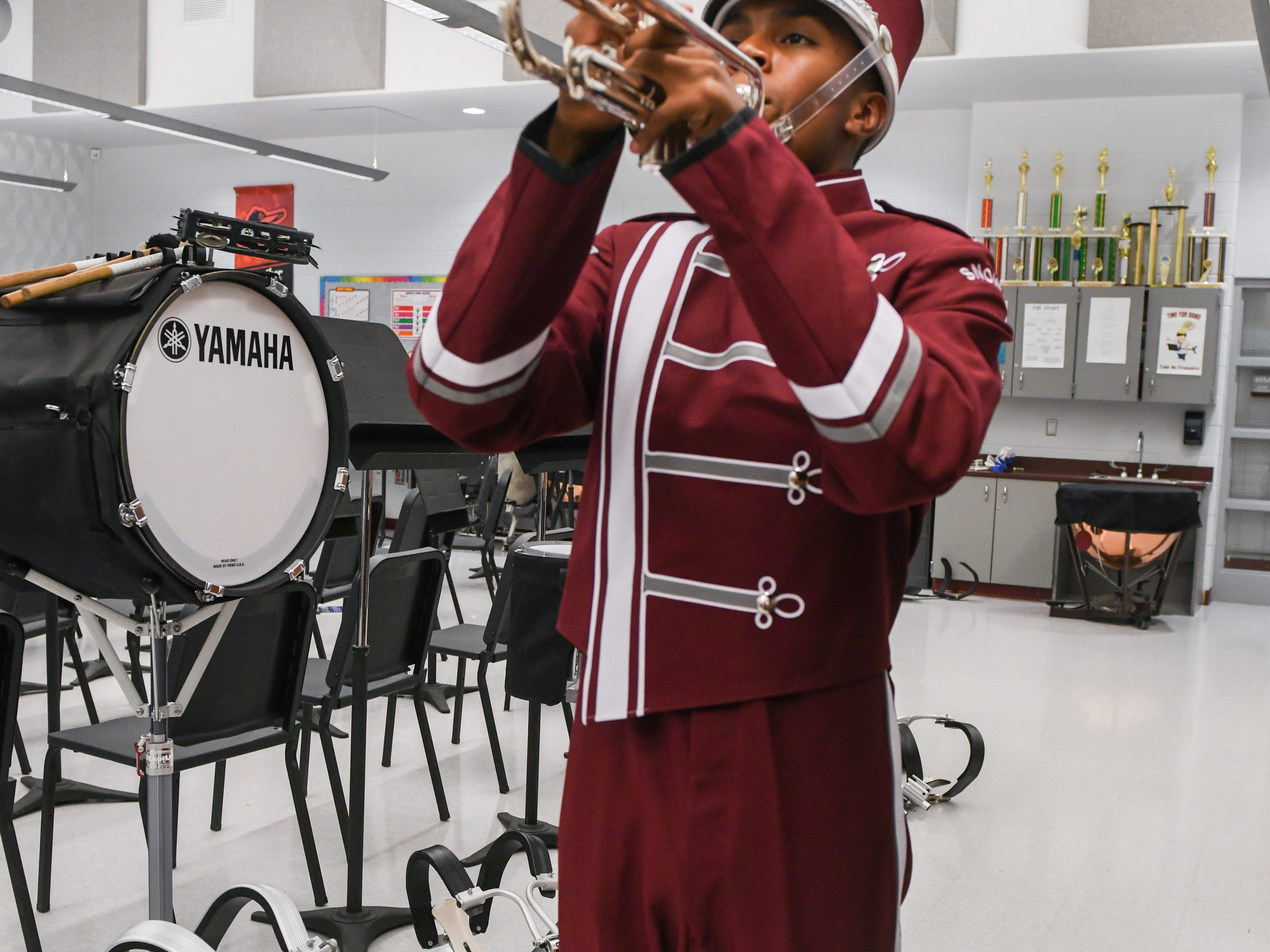 High school junior Julian Meza poses in his new band uniform in Snow Hill on Wednesday, Oct 10, 2018.