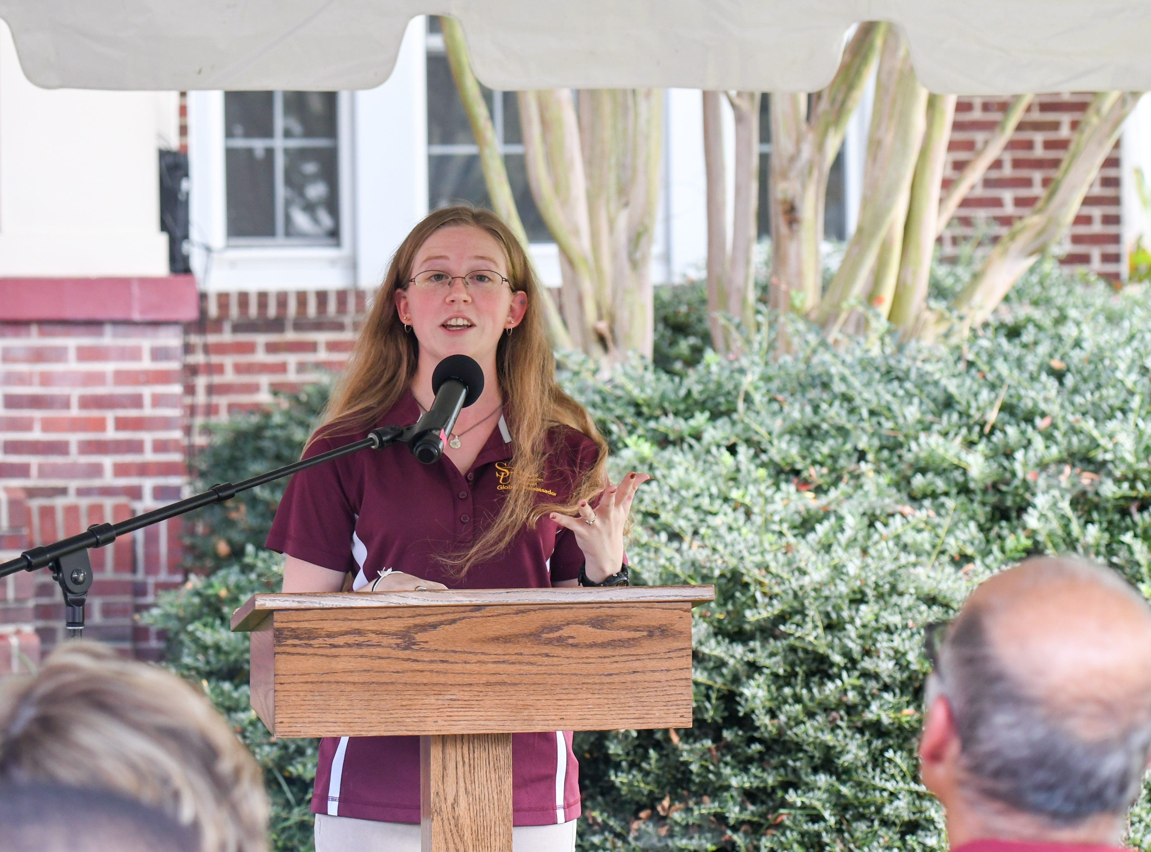 Salisbury University senior Shannon Chambers speaks at the renaming of the Center for International Education in honor of former President Janet Dudley-Eshbach on Wednesday, Oct 10, 2018.