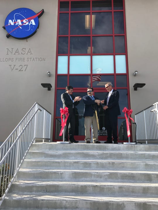 Goddard Center Director Chris Scolese, left, along with Wallops Flight Facility Fire Chief Jim Atkins and Bill Wrobel, director of Wallops Flight Facility, cut a ceremonial ribbon at the new fire station.