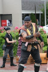 "CutThroat CorteZ and John ""Little John"" Morehouse of Pirates Plunder Entertainment Inc demonstrate proper blocking techniques during Sword School at the Belmar Pirate Walk in June."