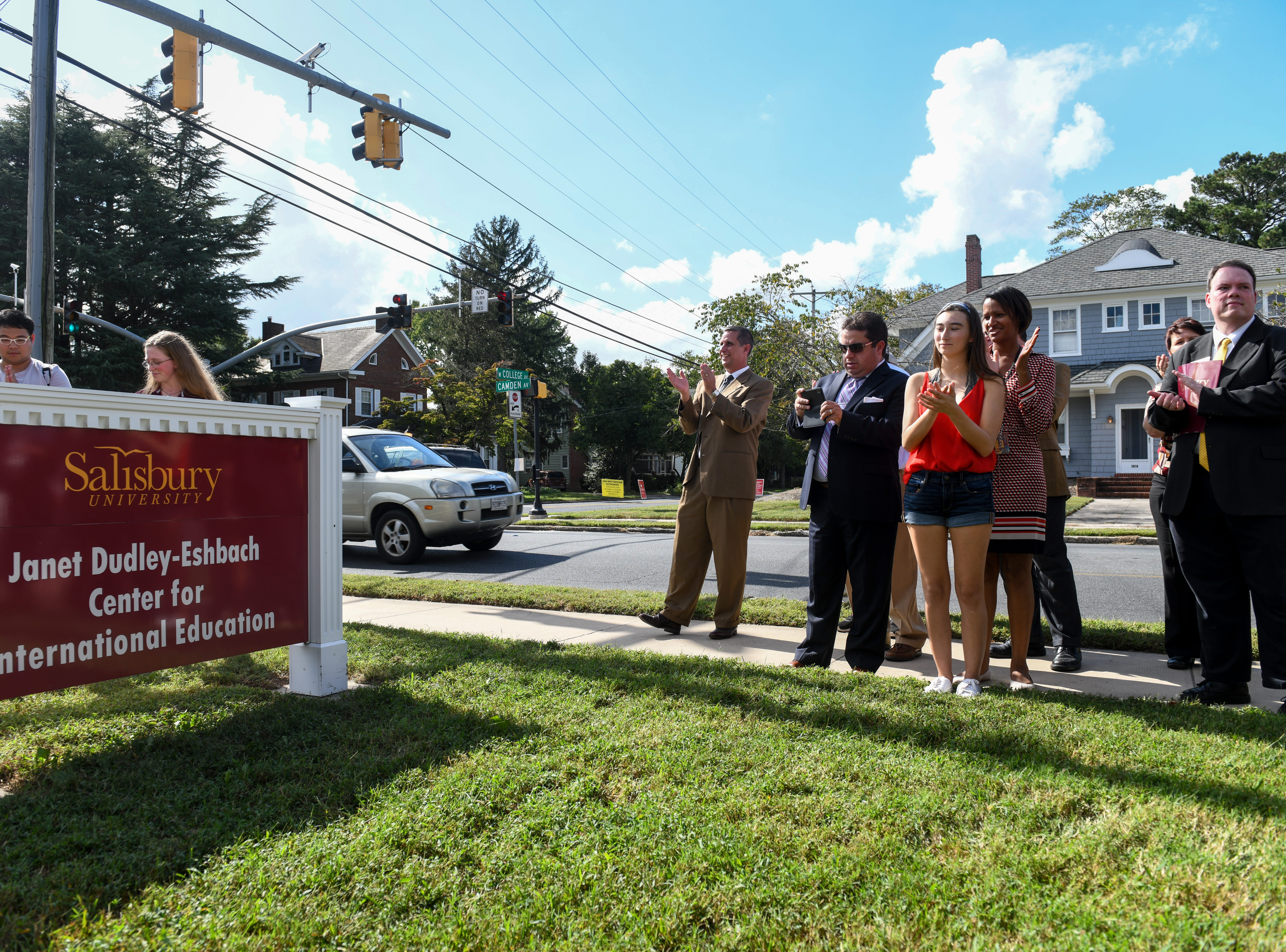 Salisbury University students Shannon Chambers and Zhengwu Yang unveil the new sign at the Center for International Education in honor of former President Janet Dudley-Eshbach on Wednesday, Oct 10, 2018.