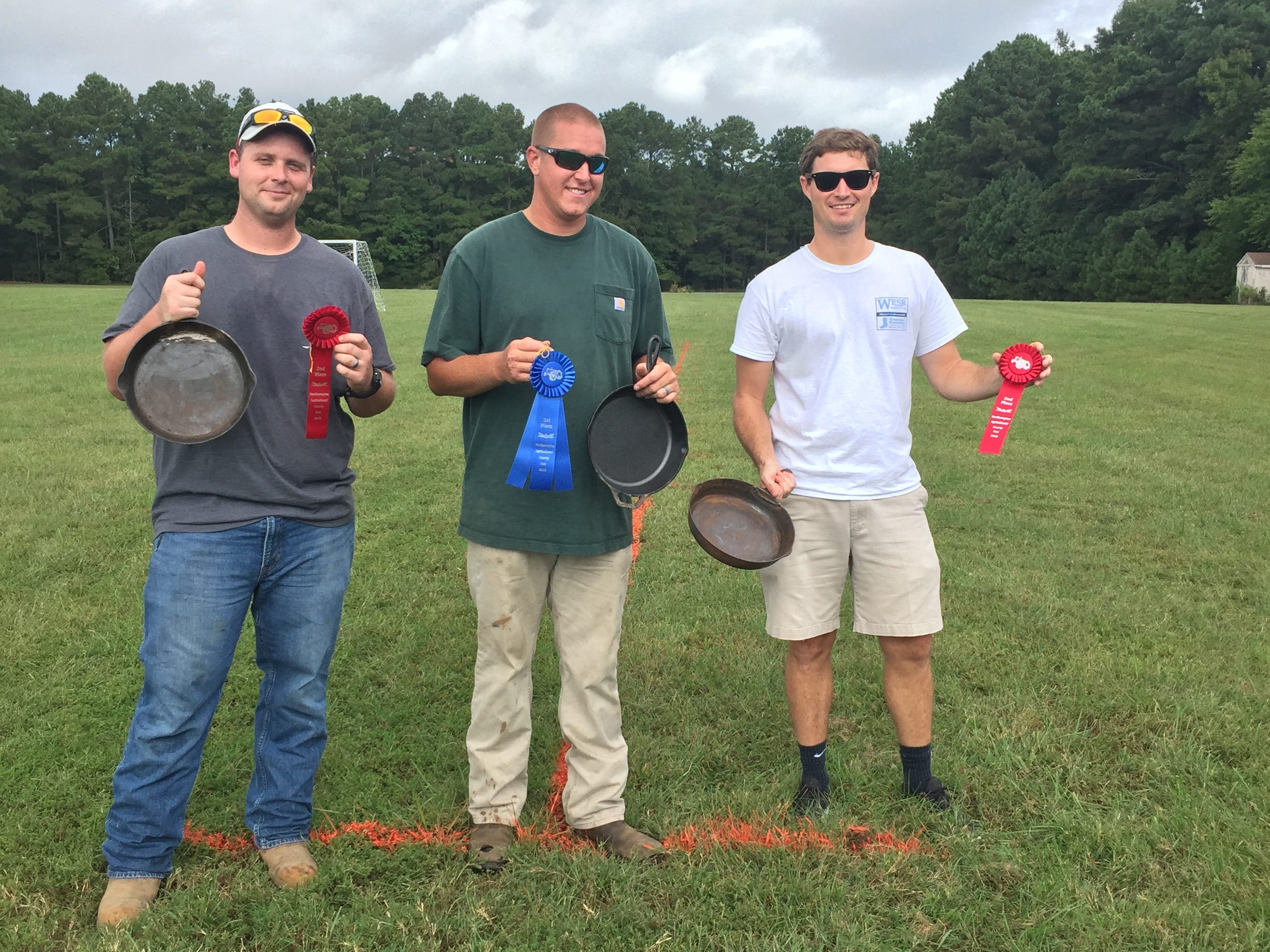 """Northampton Agricultural County Fair Skillet Throwing Contest Winners, men - 1st Place, center, Sands Gayle, with a 57'2"""" toss; tied for 2nd Place, from left, Brandon Parks and Will Russel,l with 51'3"""" tosses."""