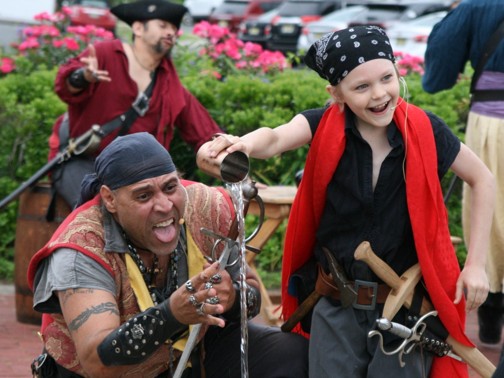 """Cuthroat CorteZ and John """"Little John"""" Morehouse of Pirates Plunder Entertainment Inc perform at the Belmar Pirate Walk  in June."""
