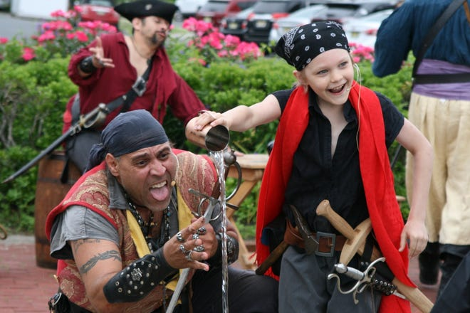 "Cuthroat CorteZ and John ""Little John"" Morehouse of Pirates Plunder Entertainment Inc perform at the Belmar Pirate Walk  in June."