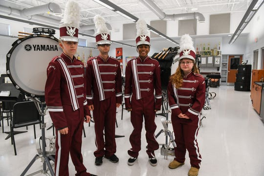 High school students Kernighan Mitchell, Justin Gentry, Julian Meza-Shockley and Rebecca Eure (left to right) pose in their new band uniforms in Snow Hill on Wednesday, Oct 10, 2018.