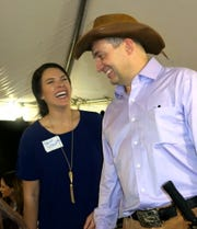 Paige Stroud and Dr. Gerard Henry share a laugh at Willis-Knighton Barbecue.