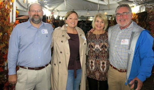 Clay and Laura Allen, Willis-Knighton Veep Margaret Elrod, Ken Paulovich at Willis-Knighton Barbecue.