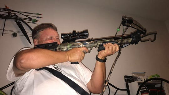 Les Mason and his new crossbow. Mason purchased a new bow the day before his death.