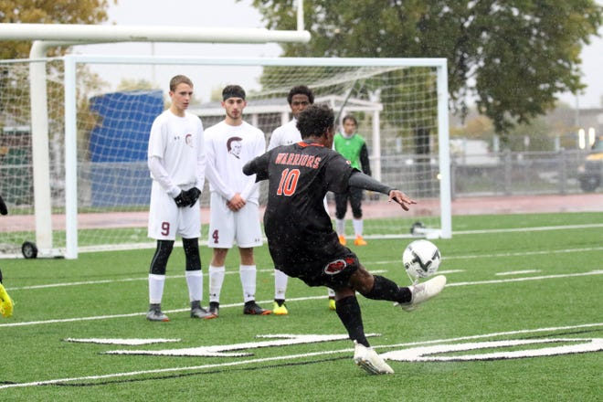 Kirubel Yerga of Washington attempts a goal kick around a wall of Spearfish defenders during Tuesday's playoff game in Sioux Falls.
