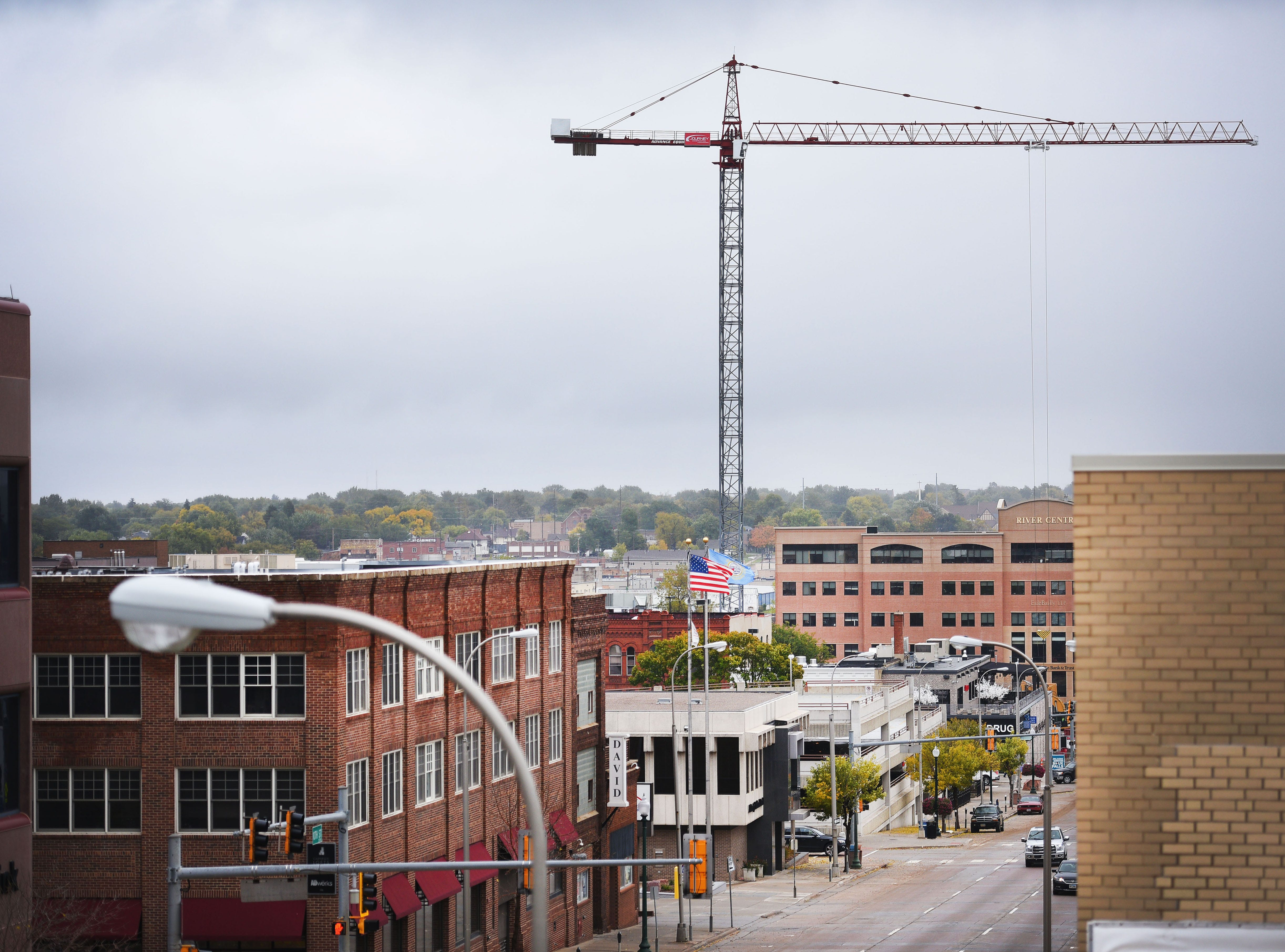 A massive crane has been erected downtown Wednesday, Oct. 10, in Sioux Falls. The crane is used to erect steel in the Village on the River mixed use parking ramp.