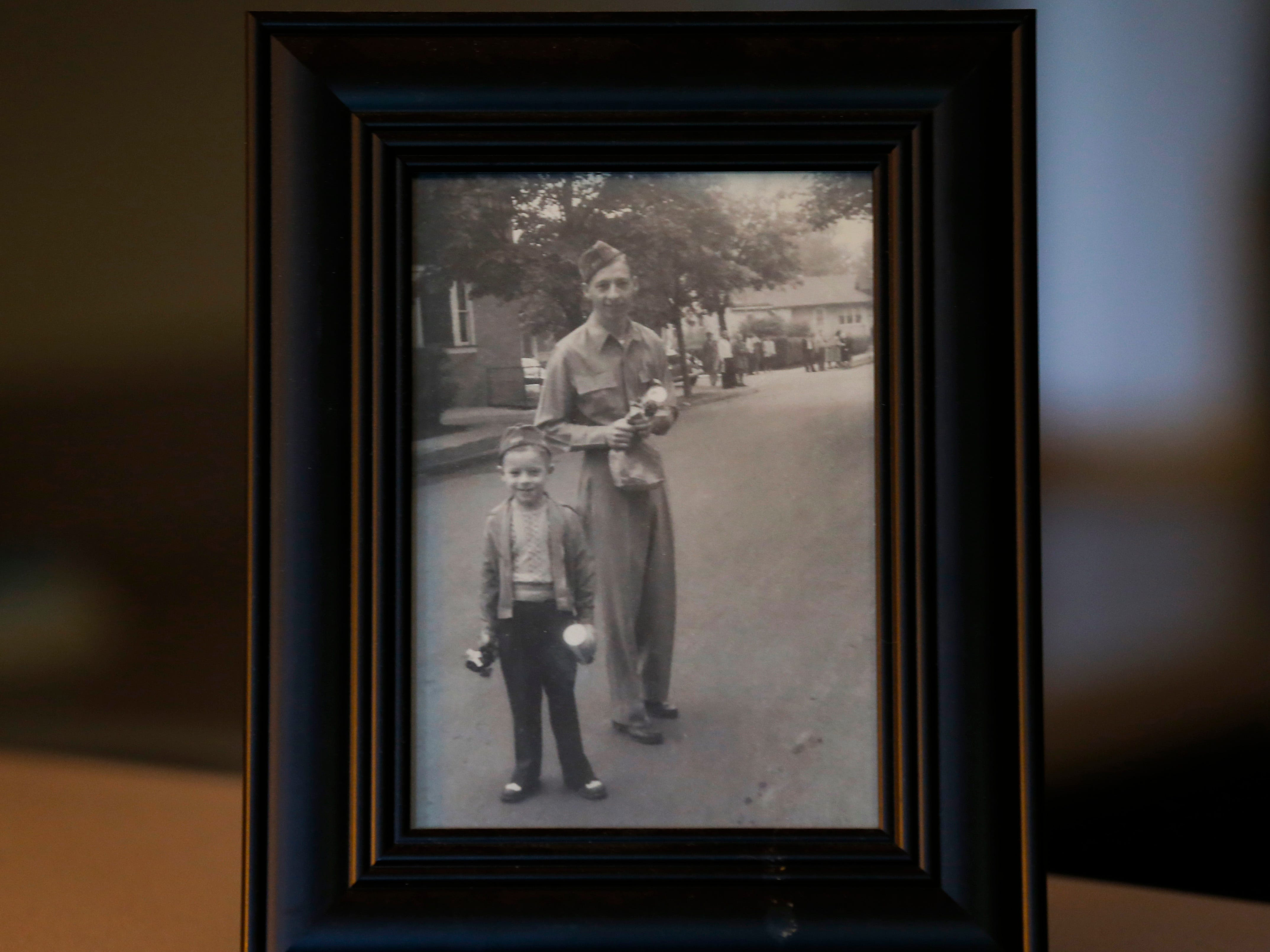 A photo of Stephen Floyd and his son after Floyd returned home from being a prisoner of war during WWII.