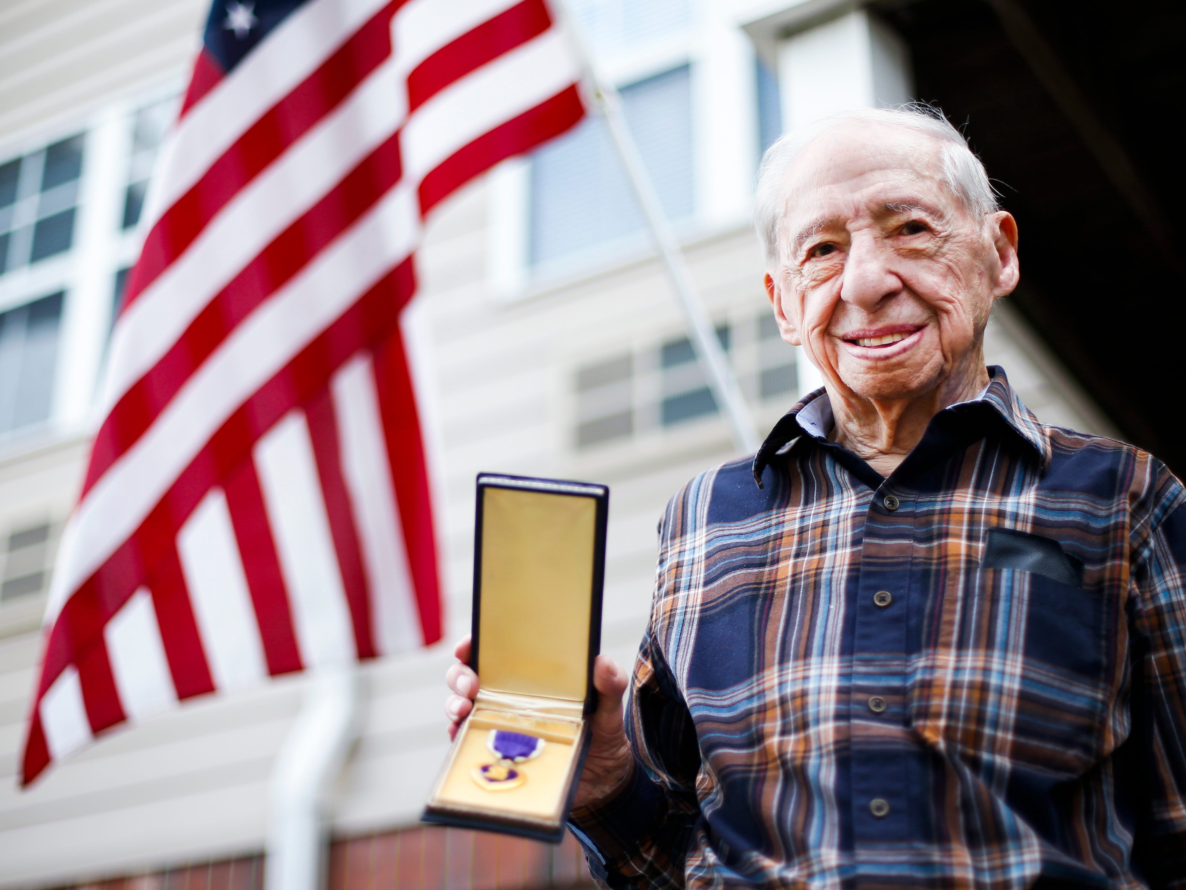 Stephen Floyd holds his Purple Heart medal that he was awarded after the B-17 bomber he was in during WWII was shot down over Germany. Floyd was a captured by Germany soldiers and was a POW for several months.