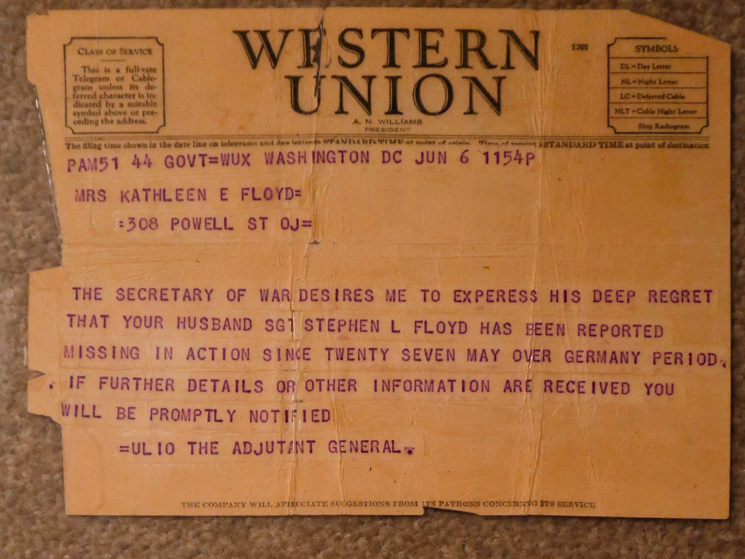 The Western Union telegrams sent to Stephen Floyd's wife from the Army informing her that he was a prisoner of war and missing in action.