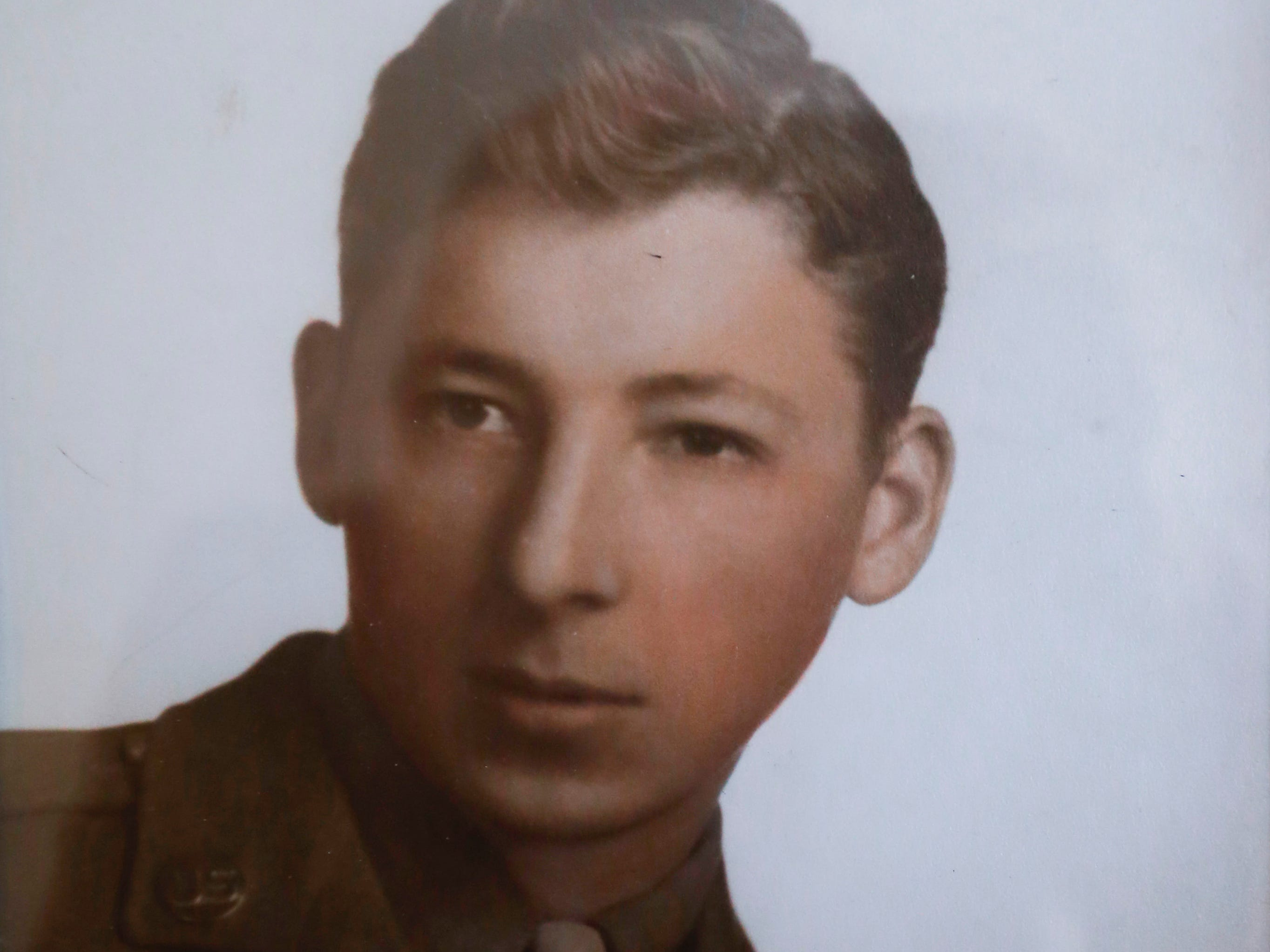 A photo of Stephen Floyd from when he was 23 and before he deployed for combat during WWII.