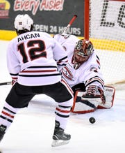 St. Cloud State goaltender Jeff Smith stretches to grab the puck during a Nov. 17 game at the Herb Brooks National Hockey Center. Smith, a senior, is 24-18-4 with a 2.73 goals-against average and .905 save percentage in 55 games with the Huskies.