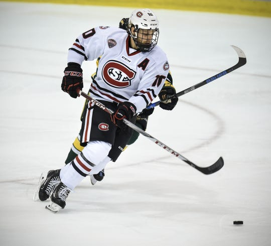 St. Cloud State's Jon Lizotte skates with the puck last season at the Herb Brooks National Hockey Center. Lizotte is one of four returning defensemen who were regulars for the 25-9-6 Huskies last season.
