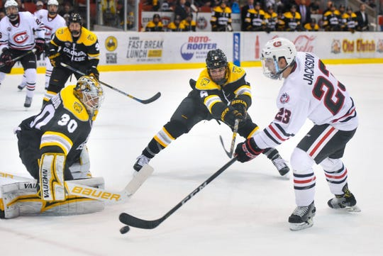 SCSU's Robby Jackson controls the puck near the Colorado College goal last season at the Herb Brooks National Hockey Center. Jackson, a senior, led the Huskies in points (42) last season in 40 games.