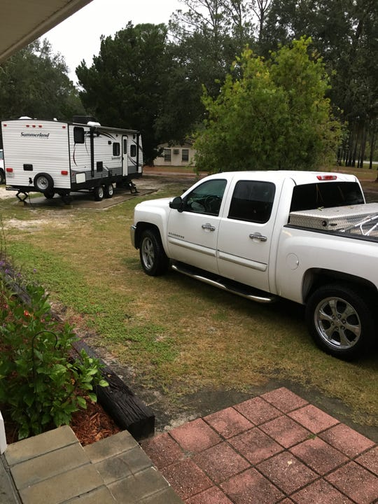 Franklin County football coach Tony Yeomans moved his camper into the front yard of his Panacea home.