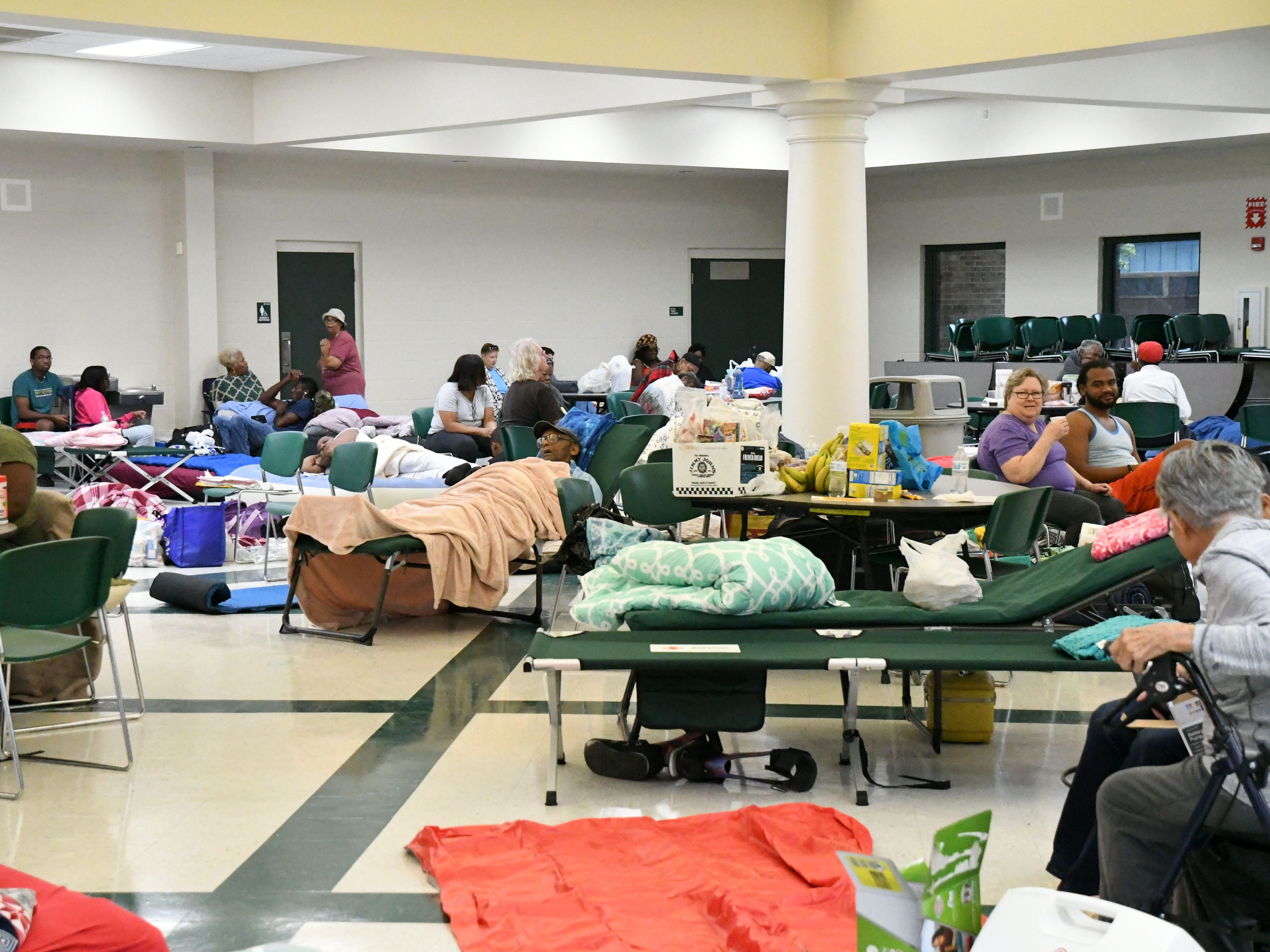 Tallahassee community members seek shelter from Hurricane Michael in the Lincoln high school cafeteria on Wednesday, Oct. 10, 2018.
