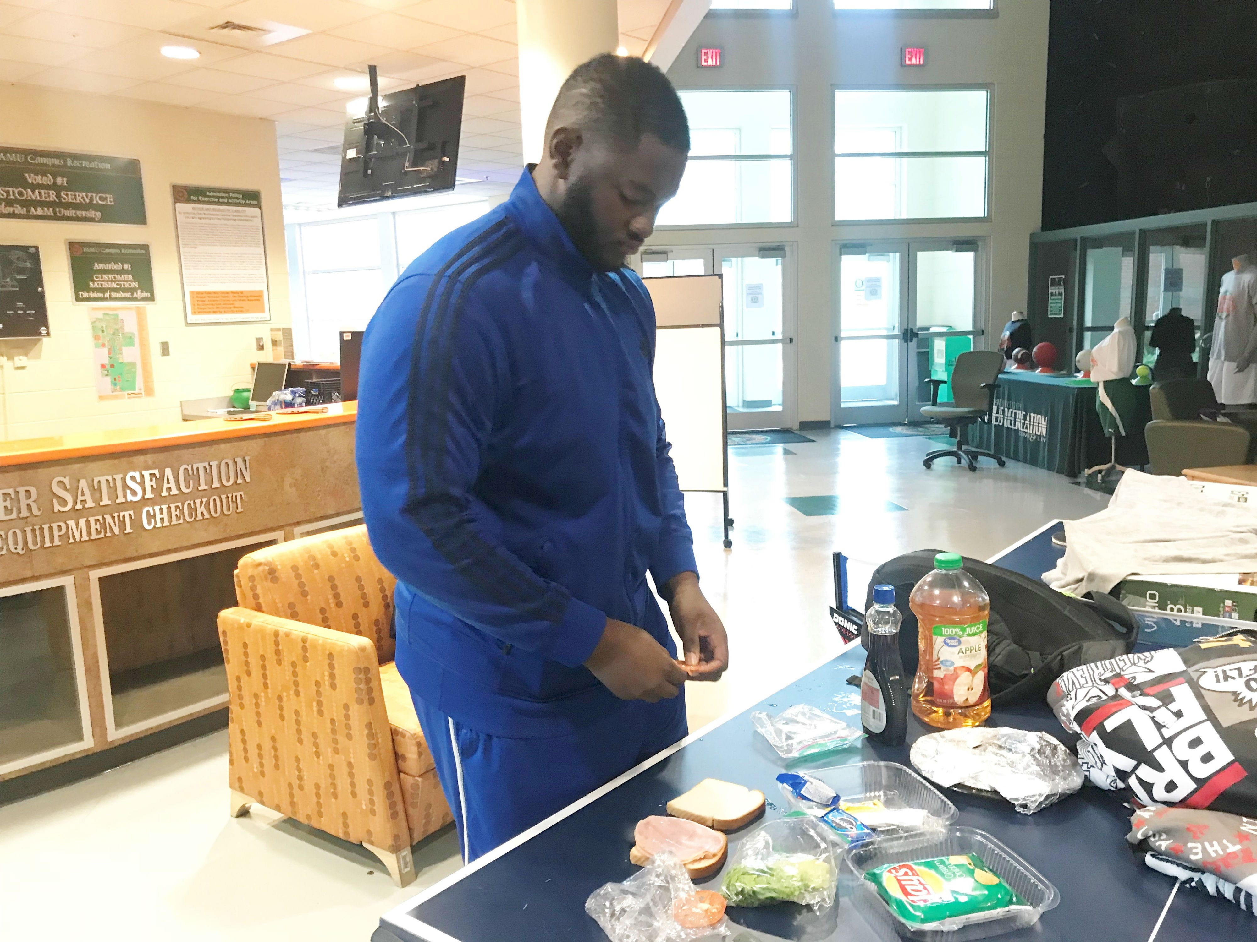 FAMU offensive lineman Jalen Brayboy makes a sandwich for lunch. The Rattlers are safe and sound inside the Hansel E. Tookes, Sr. Student Recreation Center.