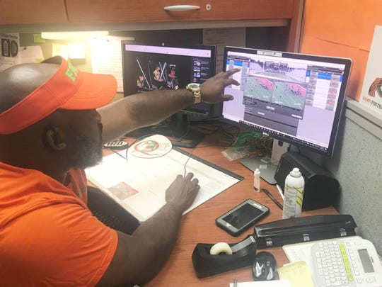 FAMU videographer Jacob Henderson reviews footage from practice.