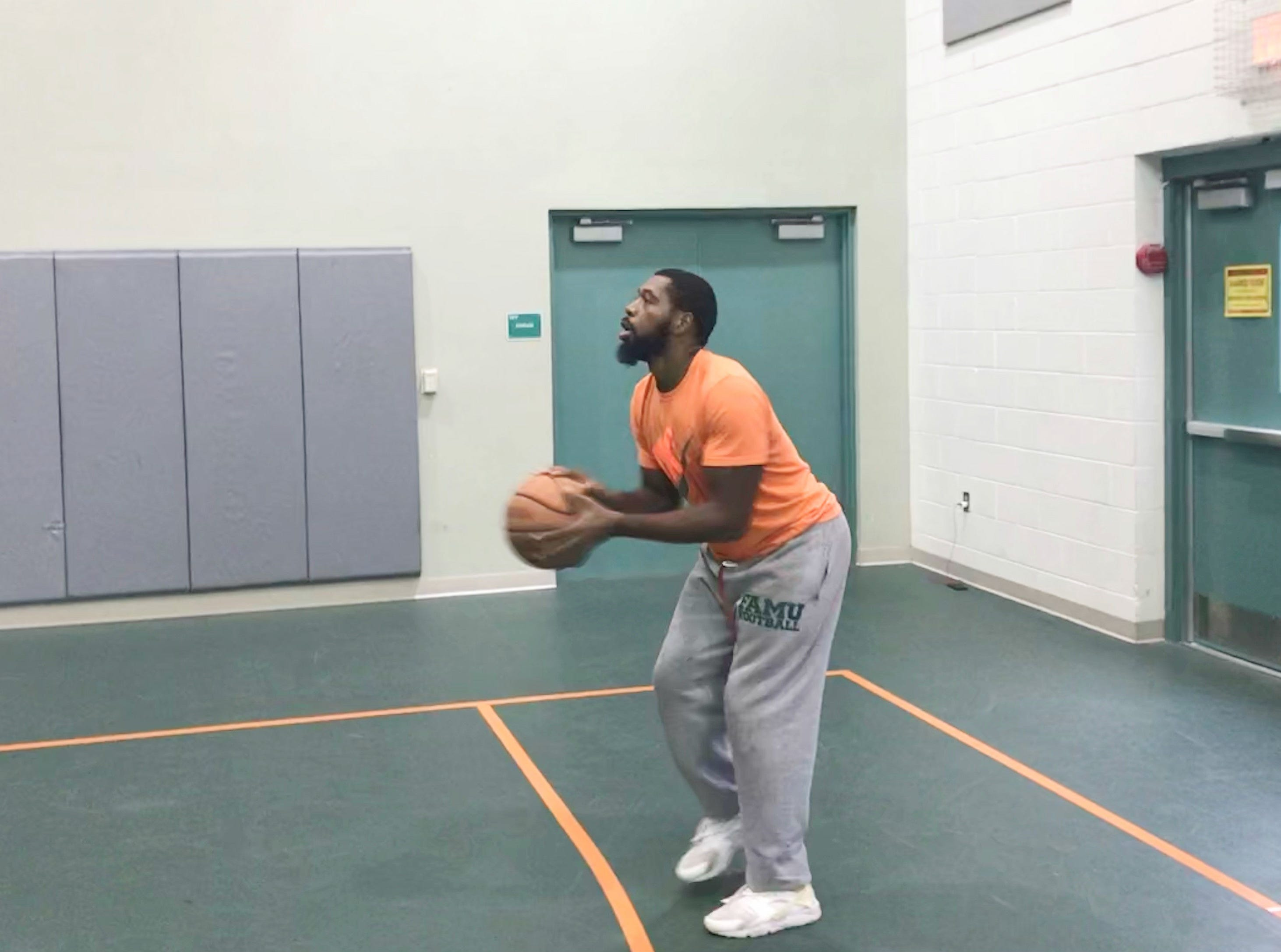 FAMU tight end Marquan Cromartie lines up for a 3-point shot. The Rattlers played basketball during their stay inside Hansel E. Tookes, Sr. Student Center.