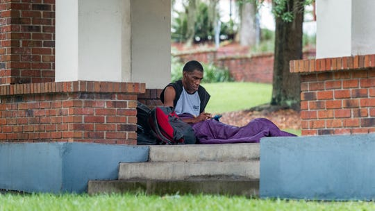 Homeless in Tallahassee  take shelter in an open gazebo at E.Peck Greene Park park as Hurricane Michael approaches the Florida Coast. Wednesday, Oct. 10, 2018.