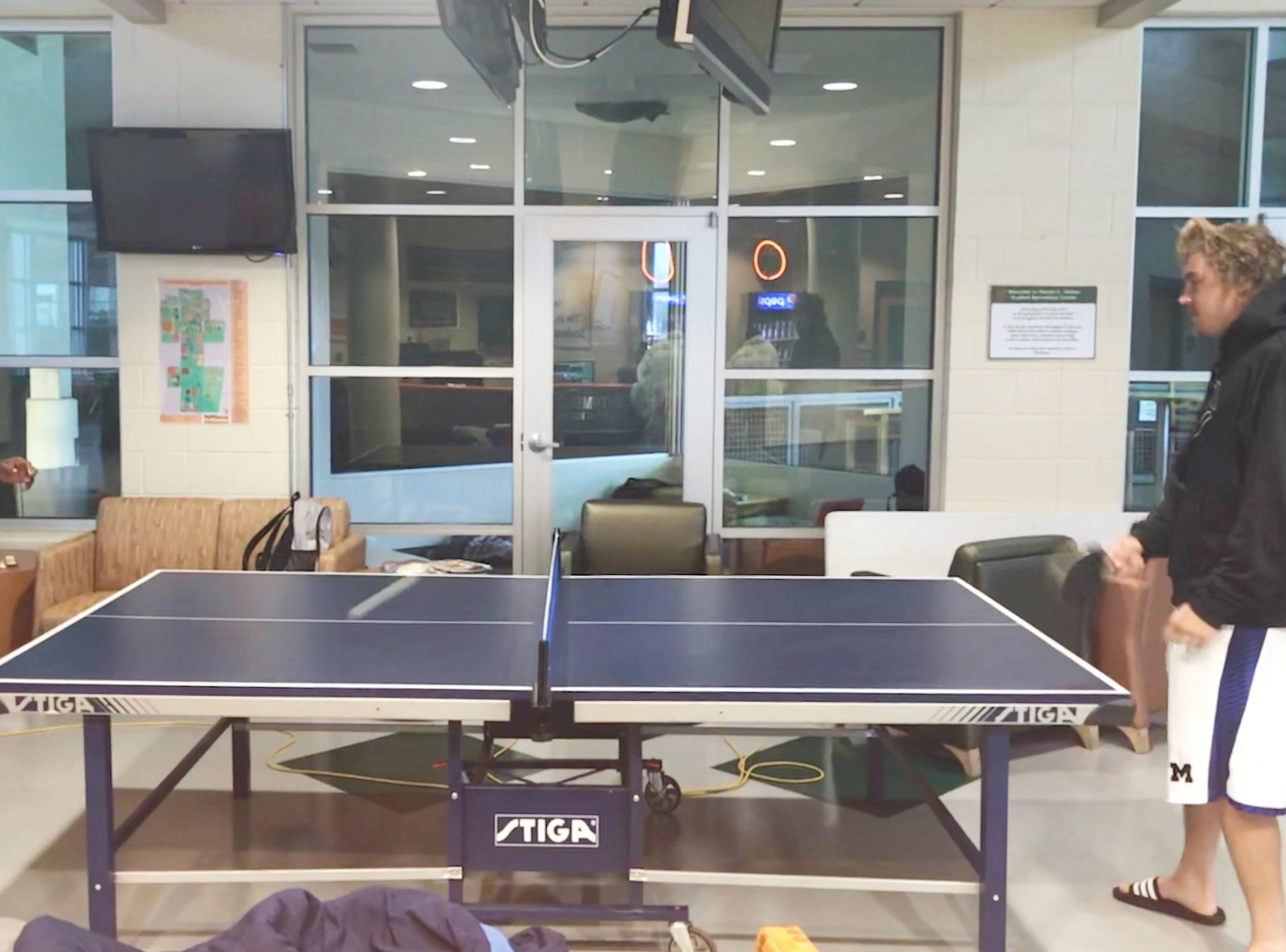 FAMU nickleback Terry Jefferson (left) plays ping pong with quarterback Ryan Stanley. The Rattlers are staying inside the Hansel E. Tooks, Sr. Student Recreation Center during Hurricane Michael.