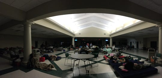 Evacuees sleep inside the Lincoln High shelter ahead of Hurricane Michael around 7 a.m. Wednesday.