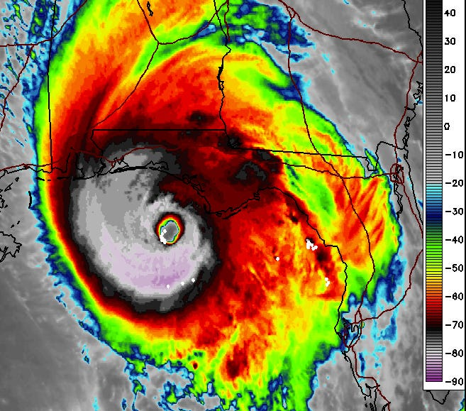 Infrared satellite imagery shows Michael with a nearly circular, symmetrical eyewall, clear inner eye, and lightning strikes continuing in the core.