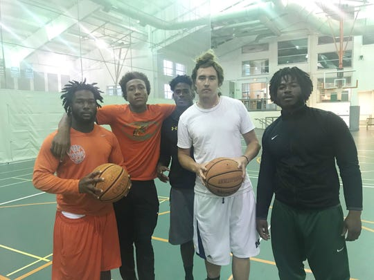 As Hurricane Michael pours down on the area, FAMU football players found safety inside the Hansel E. Tookes, Sr. Student Recreation Center. From left to right: Terry Jefferson, Nicholas Dixon, Elijah Daniels, Ryan Stanley and Alfred Smith.
