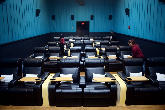 Employees Nadine Laurent (left), Melanie Smith (back) and Lacey Reed walk through and clean one of six theaters Tuesday, Oct. 9, 2018, at Touchstar Cinemas Sabal Palms Luxury 6 in Fort Pierce. The theater boasts large reclining chairs, a full-service bar and several food options other than popcorn that is delivered to you by staff. The theater is the nest to open on the Treasure Coast which opened its doors in August 2017.