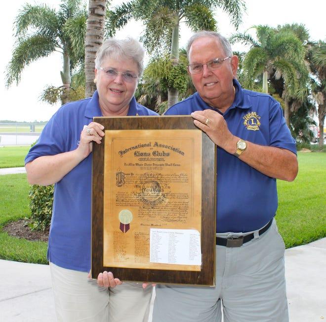 Inge & Byron Curcio with the original charter for the Vero Beach Club.