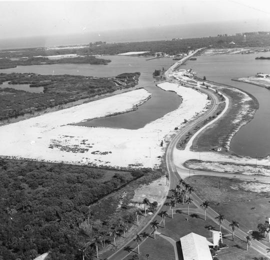 1950s - An aerial view looking to the east that shows the First Presbyterian Church and all roads leading to the new Merrill P. Barber Bridge.