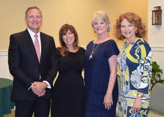 Monique Olson, second from left, with sponsors Matthew Rundels of Northern Trust, Nancy Luther of the Richardson Family, and Kerry Bartlett of Carter. Olson is president of the Indian River Chapter of the Association of Fundraising Professionals.