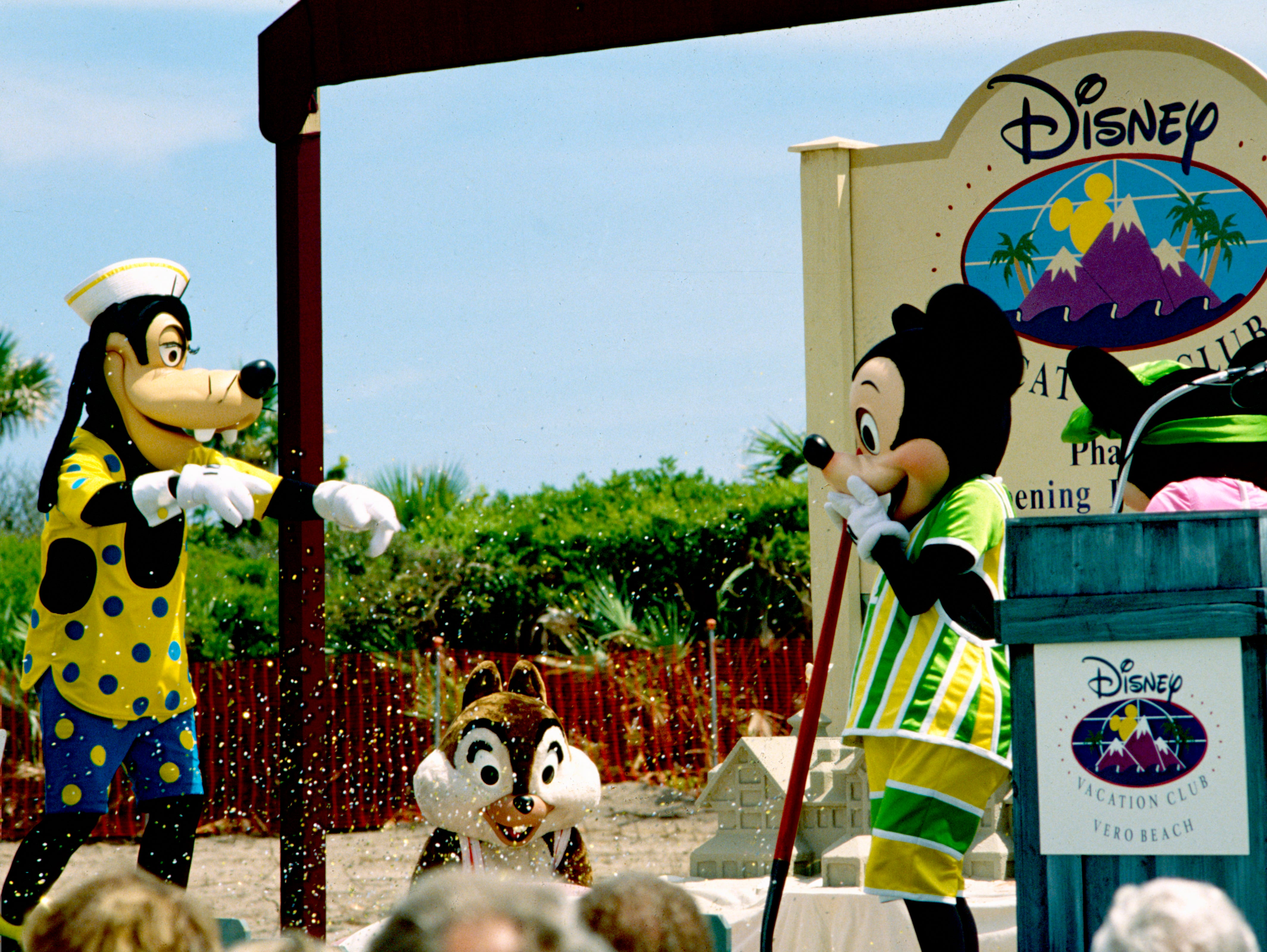 July 28, 1994 - Goofy, Mickey and Minnie sprinkle pixie dust in the air and unveil a sand castle replica of Disney's new resort during the groundbreaking ceremony at the site along State Road A1A south of Wabasso Beach. The construction marked the first time that Disney had expanded its resort business beyond the boundaries of its theme parks.
