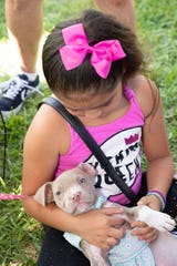 Jasmine Diaz with H.A.L.O. puppy Rose.  By the end of the day, Rose was adopted by an amazing family.