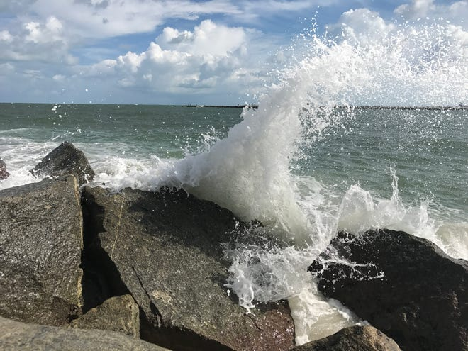 Waves from the Fort Pierce Inlet crash onto the rocks of the north jetty.