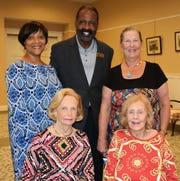 Honorees Joan Woodhouse and Nancy Johnson, seated, with Angelia Perry, Freddie Woolfork and Peggy Gibbs of Gifford Youth Achievement Center.