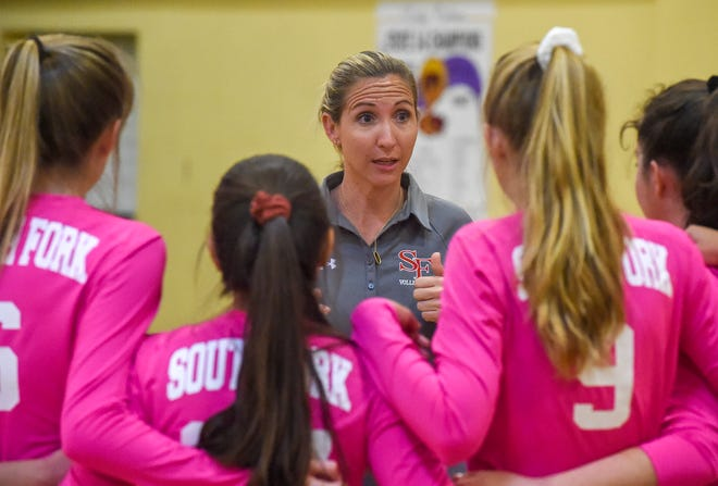 South Fork head coach Cherese Wiggins talks to her team Tuesday, Oct. 9, 2018, during their high school volleyball match against Fort Pierce Central at Fort Pierce Central High School.