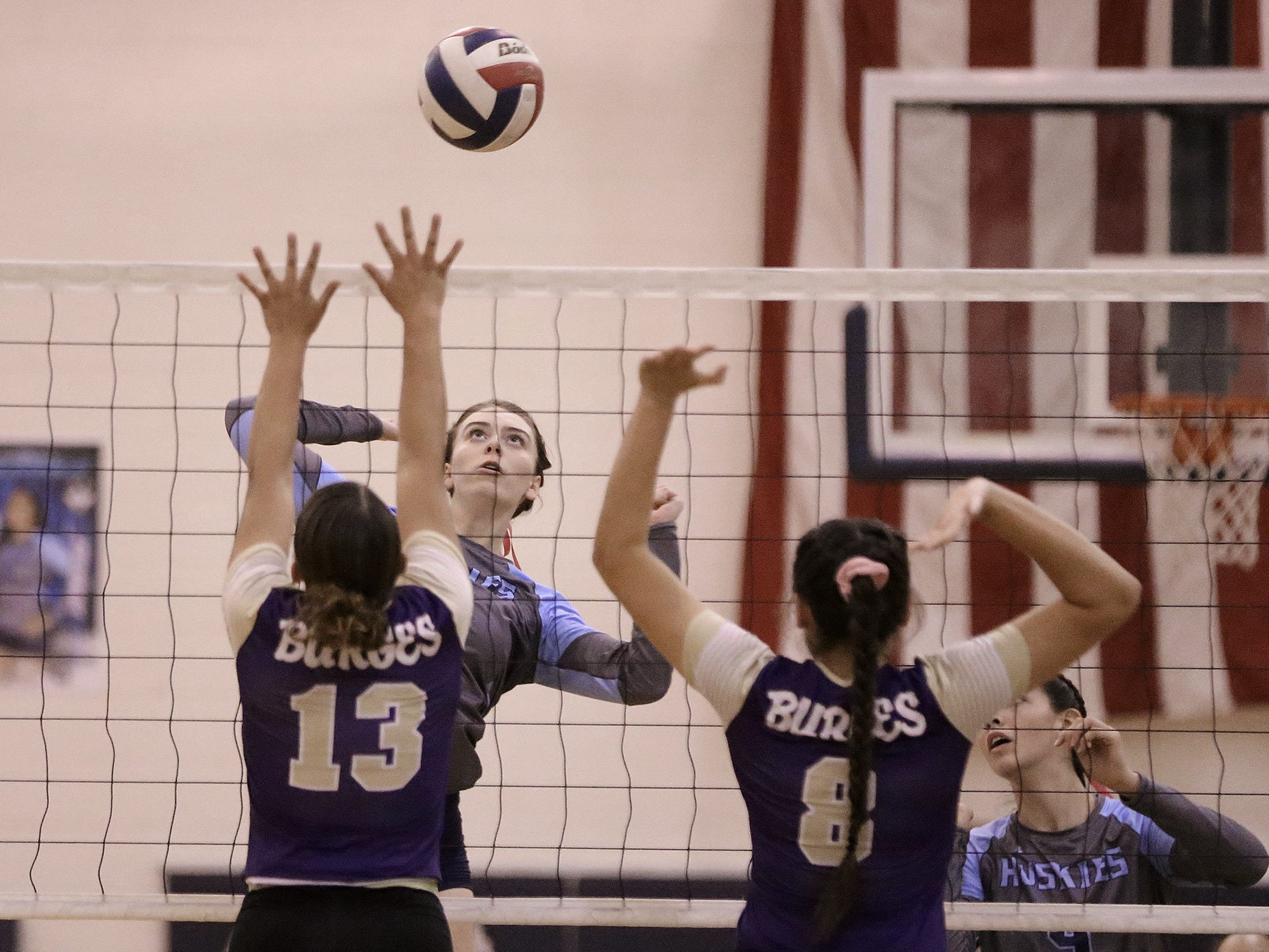 Chapin's Sydney Burnley hits into blockers Meghan Cereceres and Deandra Allen of Burges.
