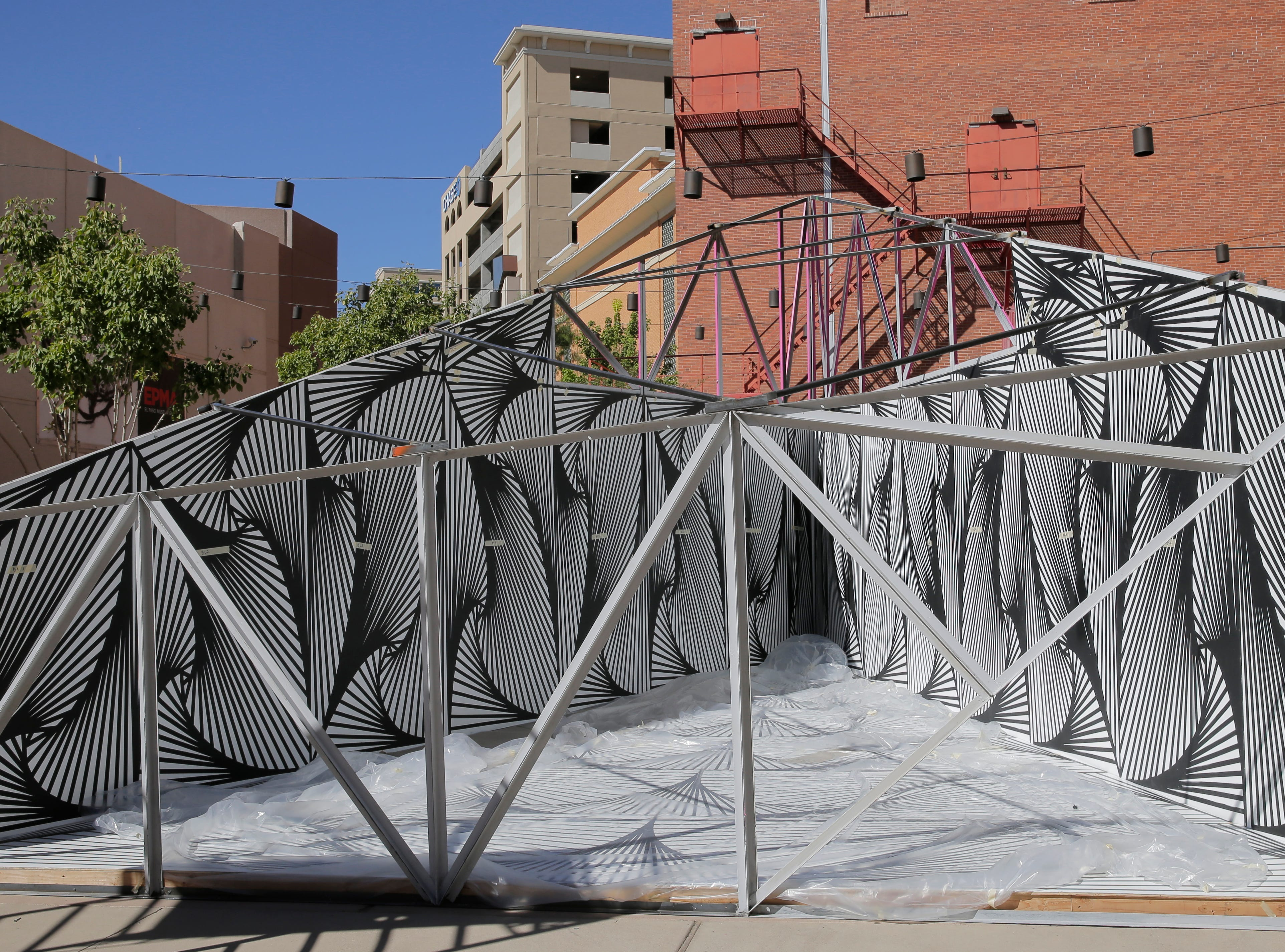 Local artist Laura Turon began installation Wednesday on her Mixed Media/Art Installation, Paradox Pyramid which is being constructed at Arts Festival Plaza for this weekends Chalk the Block event. Turon is being helped by several volunteers, including her husband Adam Gonzalez, Staphany Garnica and others