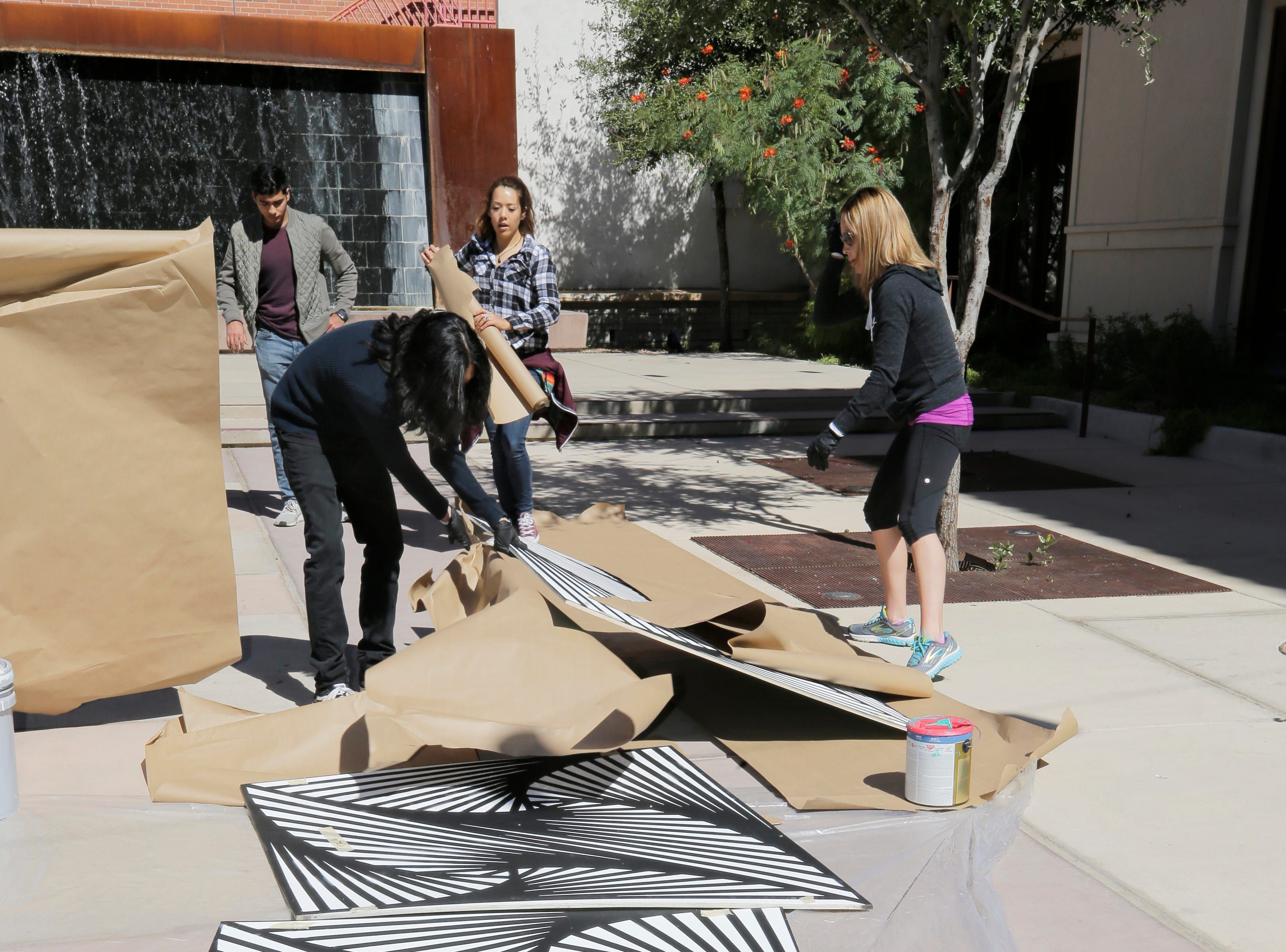 Local artist Laura Turon began installation Wednesday on her Mixed Media/Art Installation, Paradox Pyramid which is being constructed at Arts Festival Plaza for this weekends Chalk the Block event. Turon is being helped by several volunteers, including her husband Adam Gonzalez, Staphany Garnica and others.