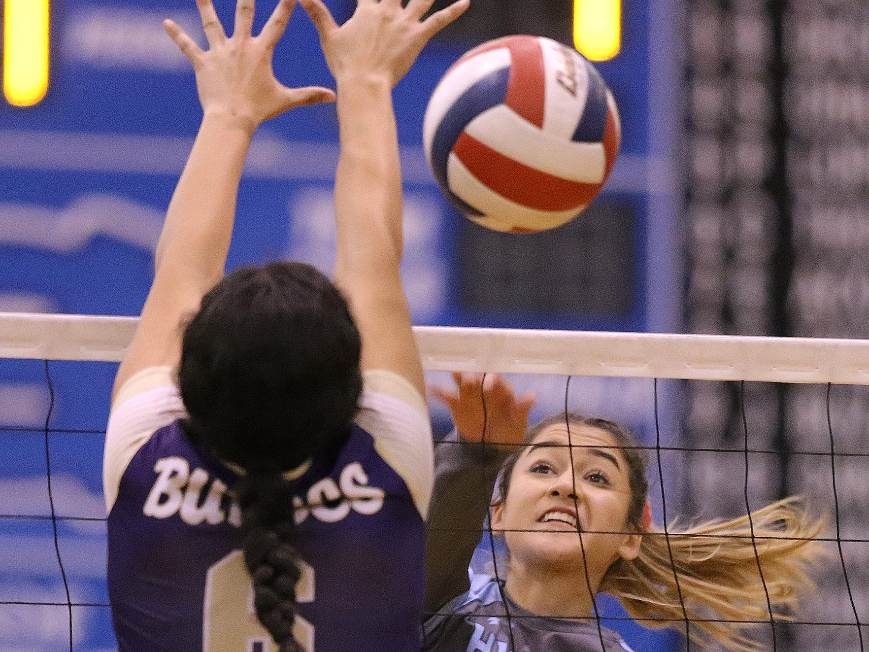 Chapin's Camila Ramirez hits around the outstretched arms of Zaira Carrillo of Burges during their match Tuesday at Chapin High School.