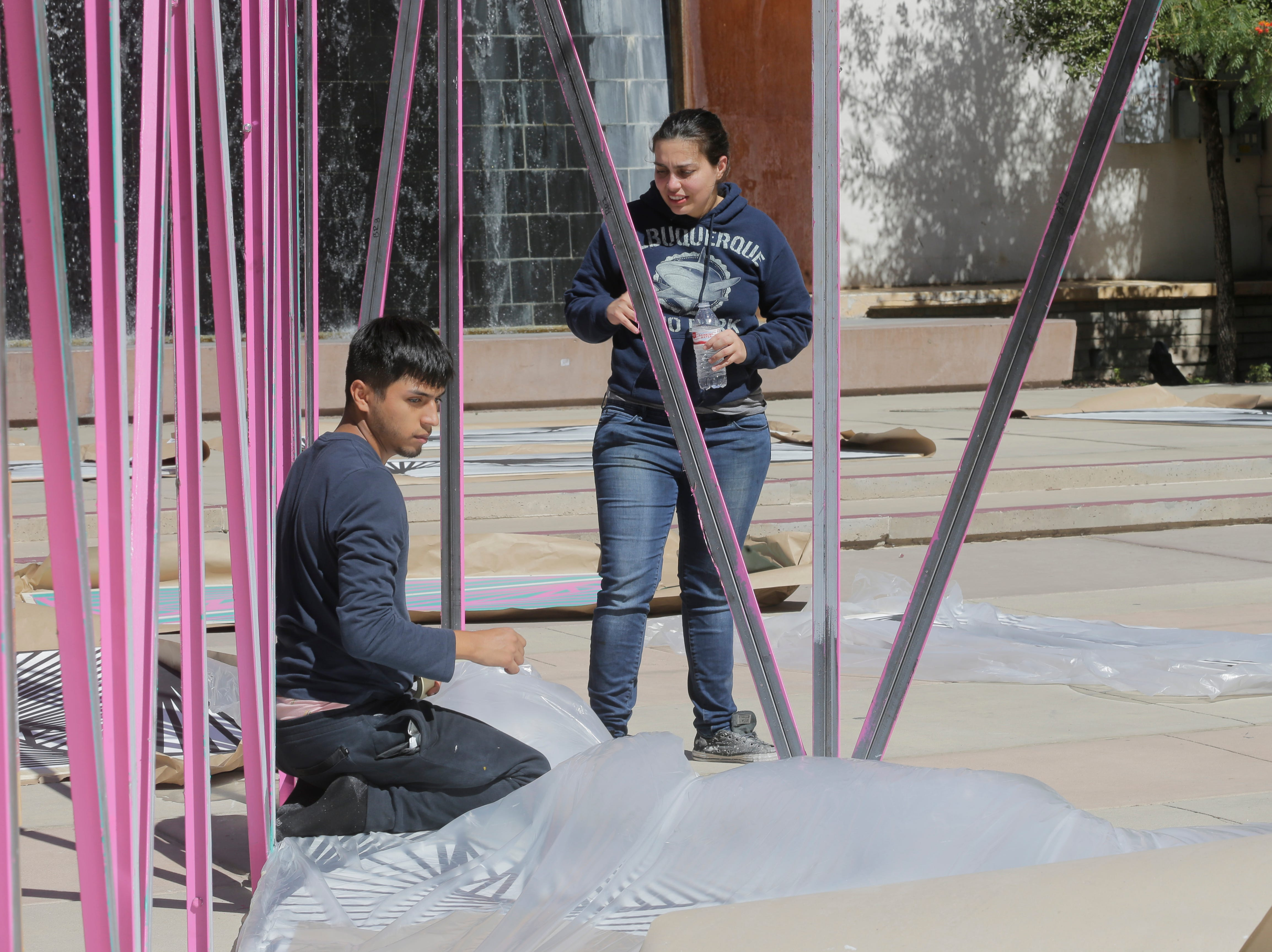 "El Paso artist Laura Turón, standing, began installation Wednesday of her mixed media art installation, ""Paradox Pyramid,"" which is being constructed at Arts Festival Plaza for this weekend's Chalk the Block event. Turon is being helped by several volunteers, including her husband, Adam Gonzalez, Staphany Garnica and others."