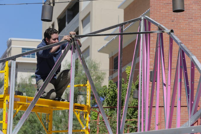 "El Paso artist Laura Turón began installation Wednesday of her mixed media art installation, ""Paradox Pyramid,"" at Arts Festival Plaza for this weekend's Chalk the Block event. She is being helped by several volunteers, including her husband, Adam Gonzalez, Staphany Garnica and others."